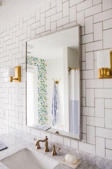 Bathroom with 90-degree herringbone pattern art deco tile on wall