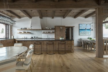 long wooden rustic kitchen island in wooden kitchen