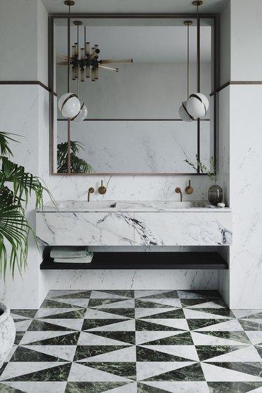 art deco tile on bathroom floor with floating marble vanity