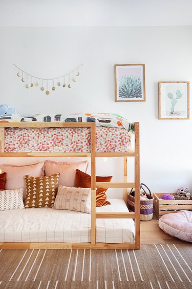 boho minimalist girl bedroom with bunk bed and striped rug