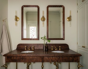 arts and crafts bathroom with vintage-inspired console vanity with brass hardware and lighting