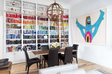 Dining room with bookshelf and art
