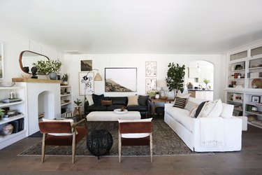 rustic family room ideas with white slipcovered couch and leather chairs