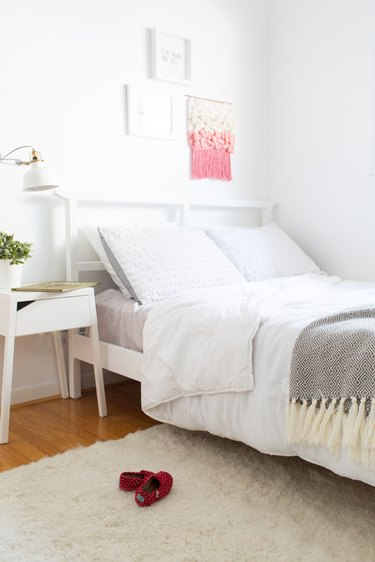 white and gray minimalist girl bedroom with shag rug