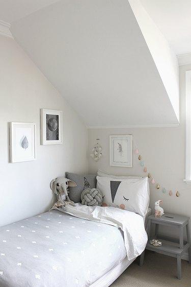 gray minimalist girl bedroom with dreamcatcher