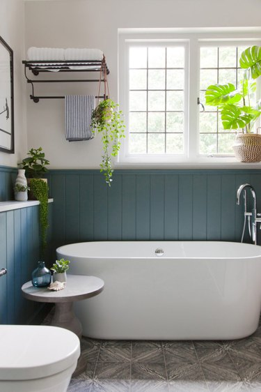 arts and crafts bathroom with freestanding tub and painted beadboard