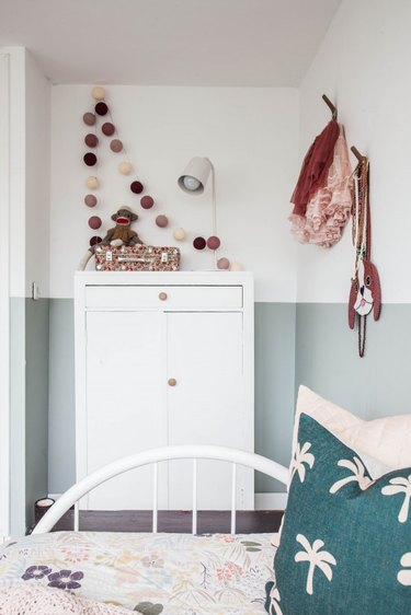 white and green minimalist girl bedroom with white dresser