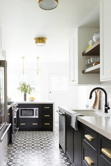 Black and white graphic art deco tile floor in black and white kitchen