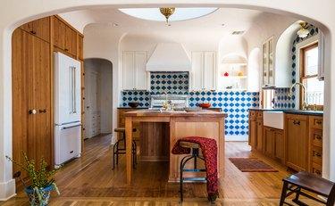 kitchen with blue and white arabesque tile backsplash