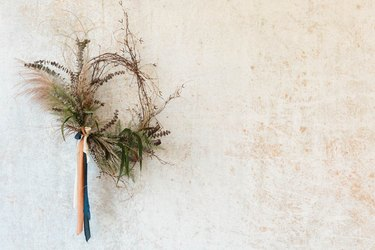 fall wreath made with victorian birch and dried ferns and ribbon