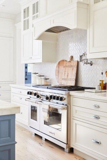 white kitchen with white arabesque tile backsplash
