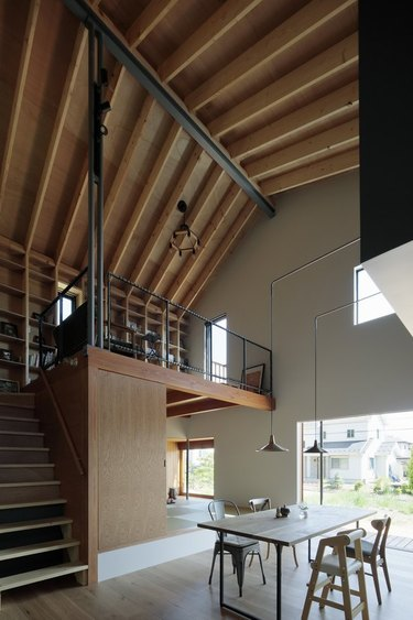 open concept living dining plus a loft office space in Japanese cabin