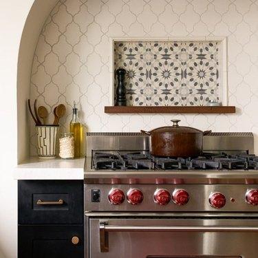 kitchen with arabesque tile backsplash behind stove