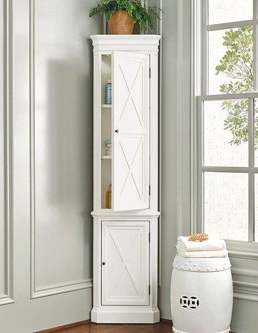 Frisco Corner Bathroom Cabinet with gray walls