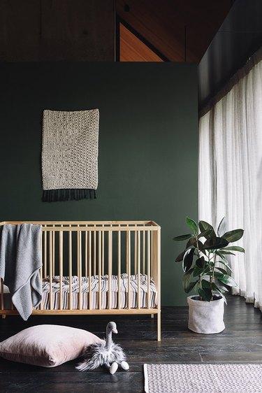 dark green minimalist nursery decor with a light crib