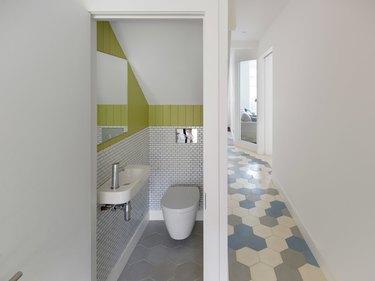 small bathroom backsplash ideas in powder room with green subway tile