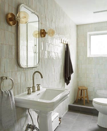 elegant bathroom lighting idea with streamlined gold wall lights