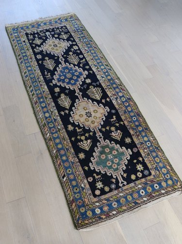 Vintage variegated runner featuring various shades of blue