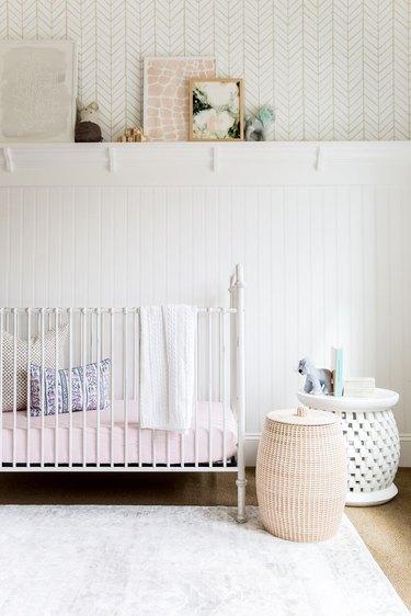 white minimalist nursery decor with wallpaper and white crib