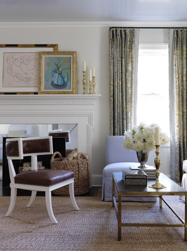 white painted fireplace with mirrored surround