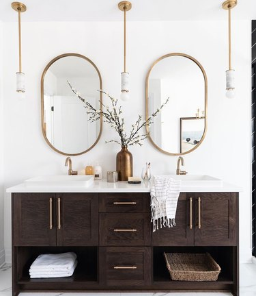 elegant bathroom lighting idea with trio of mini pendant lights with marble