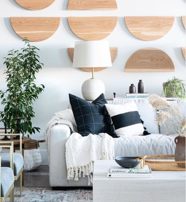 boho coastal living room with wooden half moons on walls