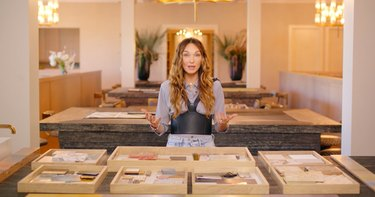Kelly Wearstler standing in front of various trays