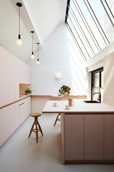 pink minimalist room paint colors in kitchen with skylight