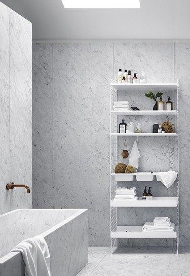 luxury marble bathroom with minimalist bathroom storage