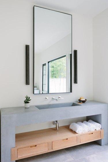 concrete open vanity in bathroom with minimalist bathroom storage