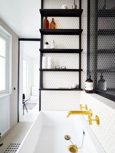 penny tile in bathroom with minimalist bathroom storage and gold faucet