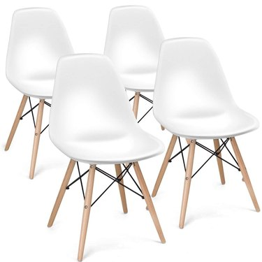Four white armless mid-century dining chairs with wooden legs