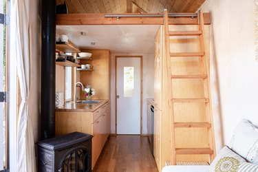Tiny house in Ojai by Sol House with loft area and furnace.