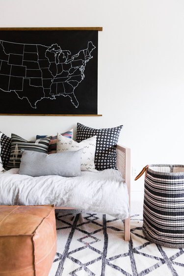 masculine boho decor in white room with sofa and pillows