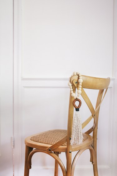 Tassel hung on back of chair