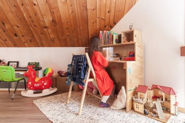 Playroom with girl reading at her wood desk