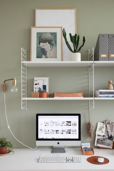 open shelving in sage green minimalist modern home office design