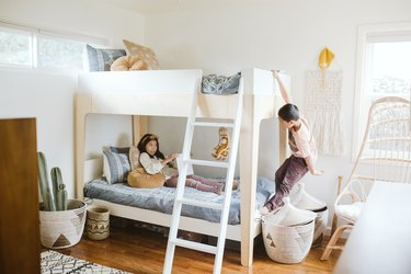 Kids playing on wood bunkbed with California cool furnishings