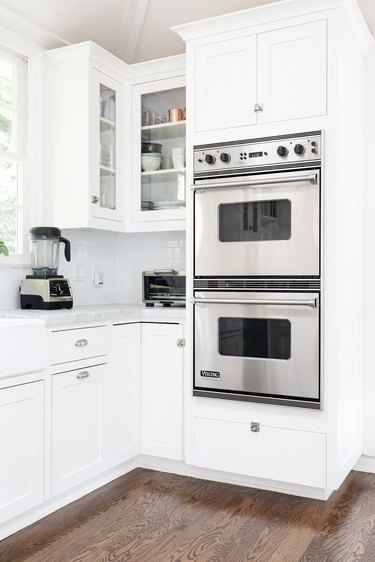 double wall oven installed in white cabinetry