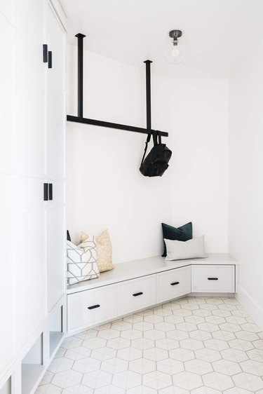 Geometric tile minimalist flooring in black and white minimalist mudroom