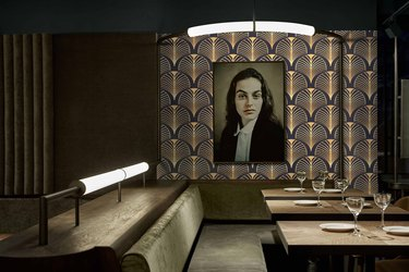Art deco room with patterned wallpaper and portrait of girl
