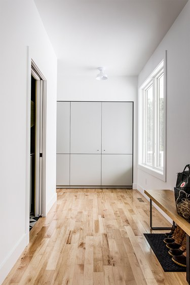 Wood plank minimalist flooring in cream and white entryway