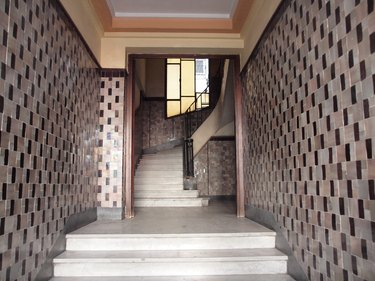Art deco hallway with patterned tile and staircase