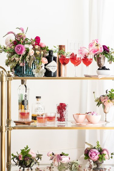 art deco themed party idea with bar cart with flowers
