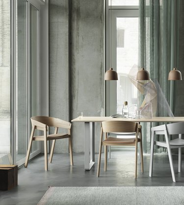 Minimalist dining room idea with gray dining room with wood and white chairs and pendant lighting