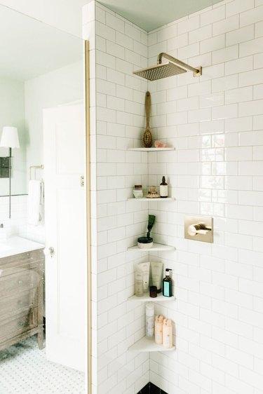 white shower with subway tile corner shower storage ideas