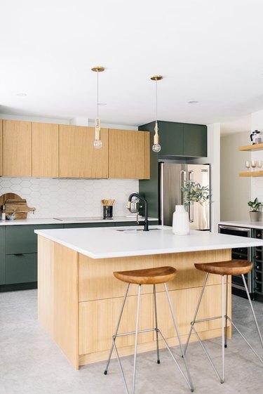 Concrete minimalist flooring in light wood and green modern kitchen