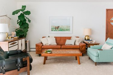 carpet family room flooring ideas with leather couch and light blue accent chair