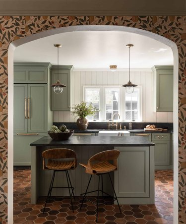 eclectic kitchen island ideas with seating, wallpaper, and brick hex floor