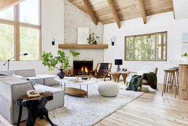 family room flooring ideas with reclaimed beechwood floors and wood ceiling beams